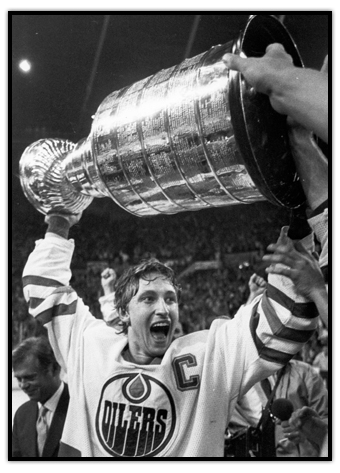 Wayne Gretzky raising the Stanley Cup over his head